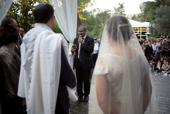Rabbi Chuck Davidson holds a wedding service in Ein Hemed, near Jerusalem, December 14, 2017.