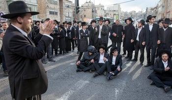 Haredi men block road in anti-draft protest, Jerusalem, March 2017.