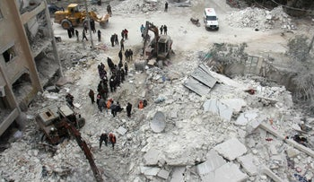 File photo: Members of the White Helmets search for victims amid rubble following an airstrike in northwestern Syria, March 15, 2017.