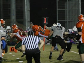 The Rebels' Chaim Aaron diving for the tying TD.