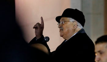 Palestinian president Mahmud Abbas (C) delivers a speech in the West Bank city of Ramallah on December 31, 2017.