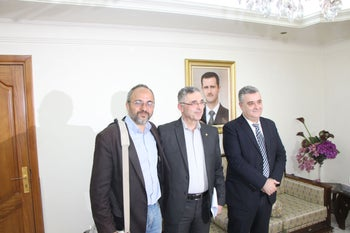 Jonathan Spyer (left) poses for a picture with Syrian Minister of Reconciliation Ali Haidar and Minister of Information, Mohammed Tourjeman, while on a government-sponsored tour of Damascus in April 2017.