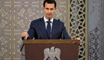 FILE PHOTO: Syrian President Bashar Assad speaks to Syrian diplomats, in Damascus, Syria.