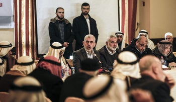 Yahya Sinwar leader of the Islamist Hamas movement in the Gaza Strip, speaks with the heads of families in Gaza City to discuss recent reconciliation developments, December 26, 2017.