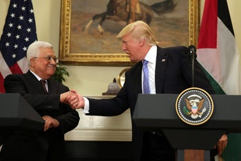 U.S. President Donald Trump shakes hands with Palestinian President Mahmoud Abbas at a more amicable time, May 3, 2017, at the White House in Washington D.C.