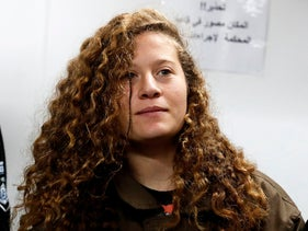 Sixteen-year-old Ahed Tamimi stands for a hearing in the military court at Ofer military prison in the West Bank village of Betunia on January 1, 2018.
