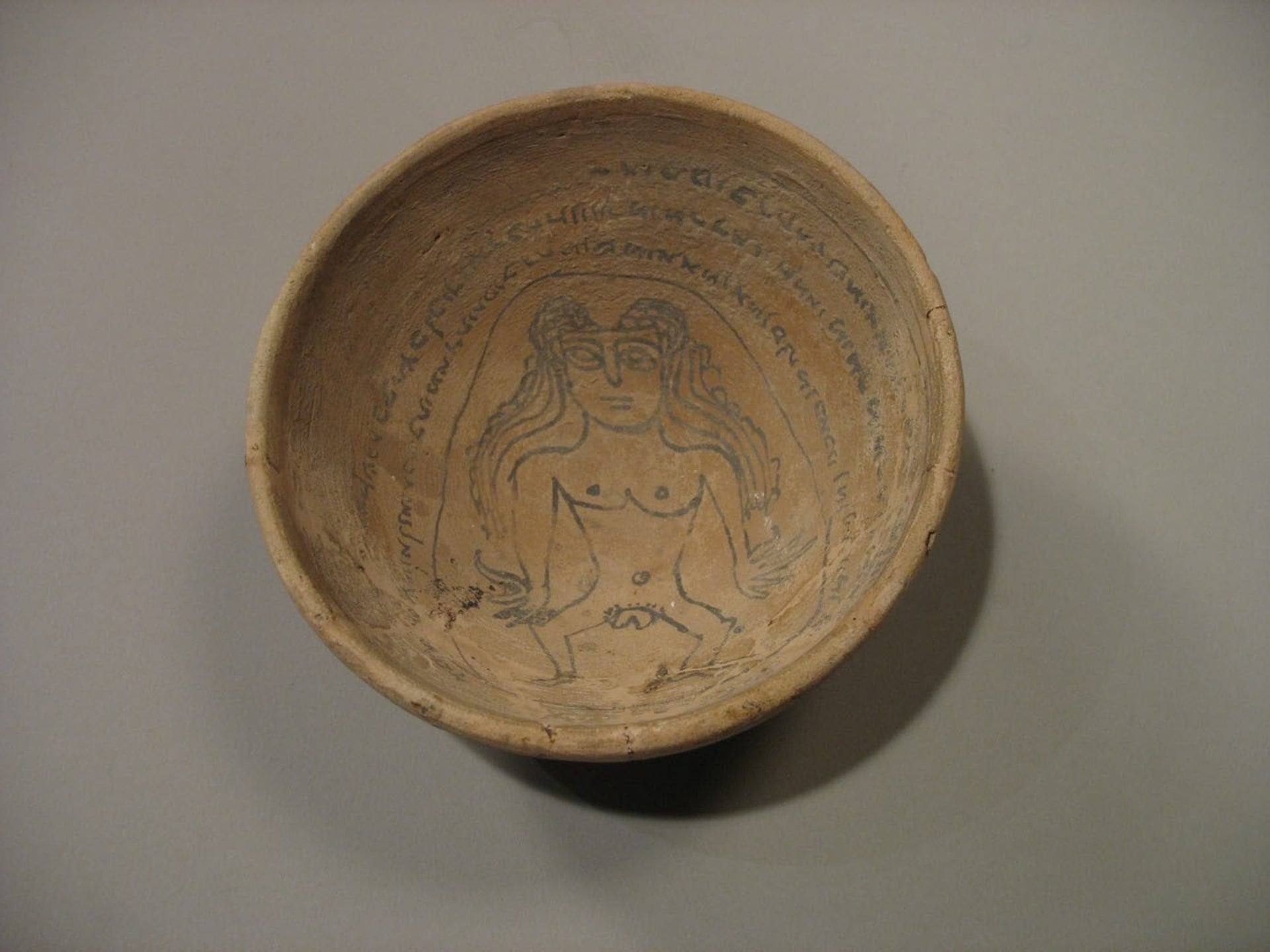 Illustration of Lilith on an earthenware vesse.