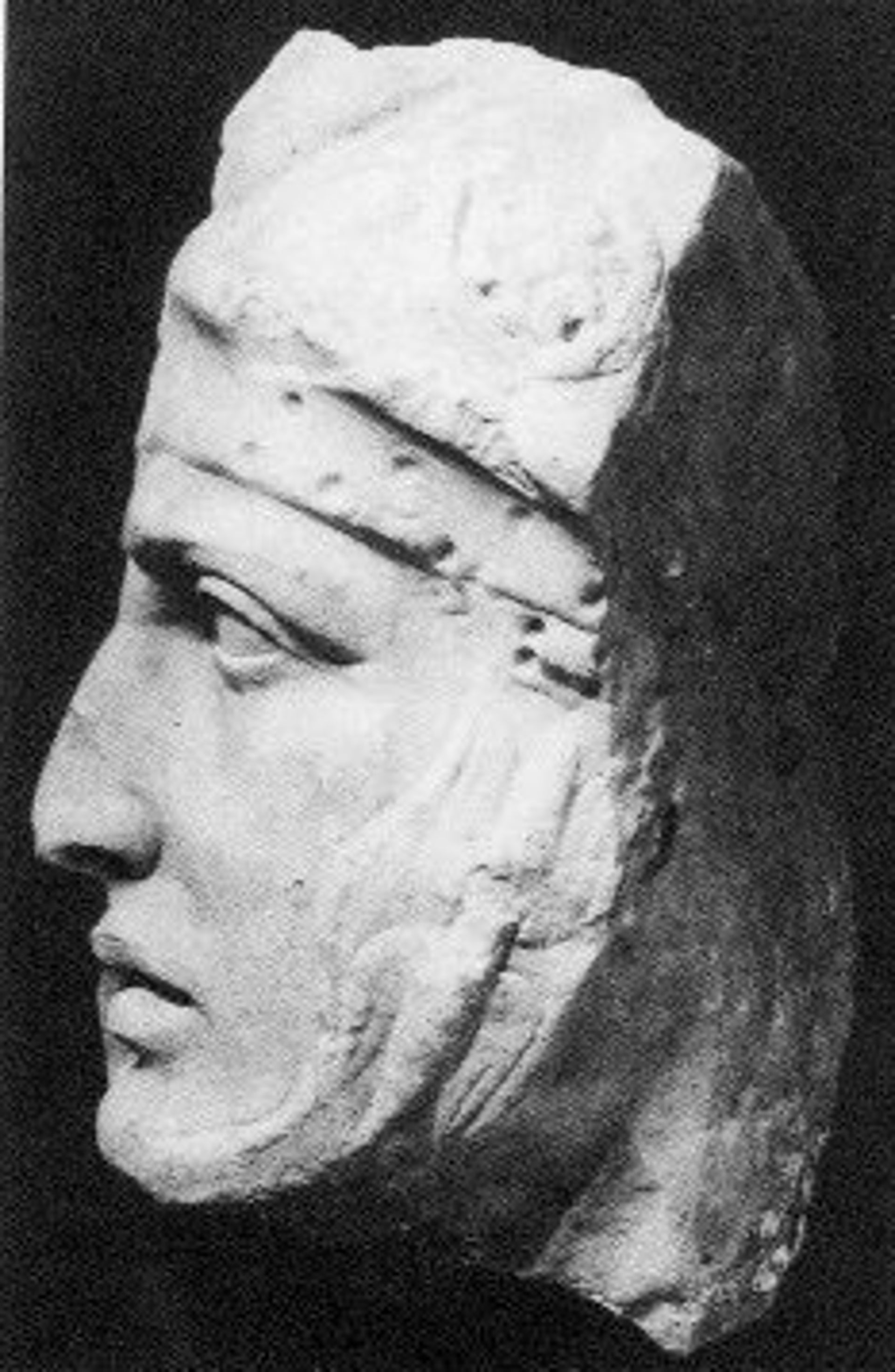 A fragment of a relief depicting the head of a Roman soldier, one of the few surviving pieces of from the arch's decorations.
