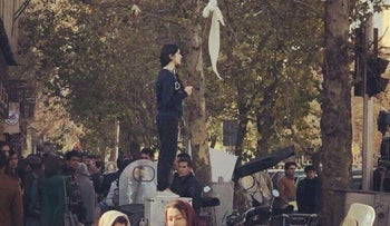 This image of a young Iranian woman raising her hijab has become a symbol of protests rocking the country for the past week.