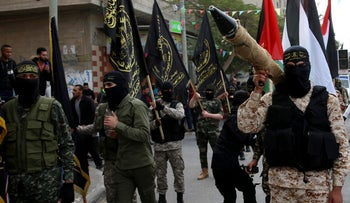 Members of Islamic Jihad's military wing march near the Nusseirat refugee camp in the Gaza Strip, December 22, 2017.