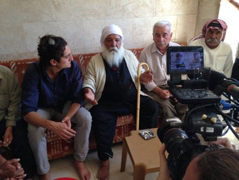 Adam Valen Levinson, left, speaking with Yazidi elders in Lalish, northern Iraq, after many of the locals had fled from ISIS.