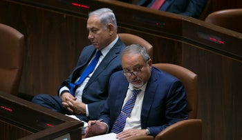Prime Minister Benjamin Netanyahu, left, and Defense Minister Avigdor Lieberman at the Knesset, October 24, 2017.