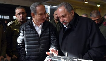 Prime Minister Netanyahu and Defense Minister Lieberman visiting a military base last year.