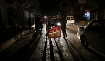 Jan. 6, 2016 file photo: a power outage at the main street in Jebaliya refugee camp, Gaza Strip.