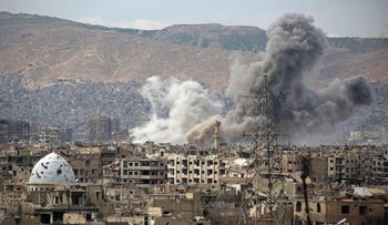 Smoke rises from buildings following an airstrike on Jobar, a rebel-held district on the eastern outskirts of Damascus, Syria, March 21, 2017.