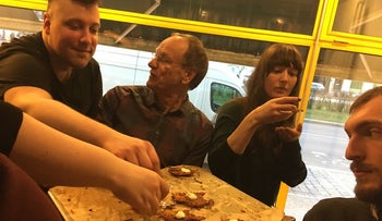"""Attendees at an event celebrating Polish-Jewish cuisine — part of Berlin's """"first-ever Jewish food week"""" — sample fresh potato latkes, March 20, 2017"""