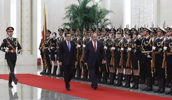 Israeli Prime Minister Benjamin Netanyahu, right, and Chinese Premier Li Keqiang review an honor guard during a welcome ceremony at the Great Hall of the People in Beijing, Monday, March 20, 2017.