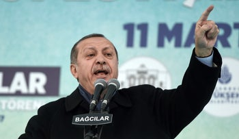 Turkish President Recep Tayyip Erdogan addresses supporters during a rally in Istanbul on March 11, 2017.