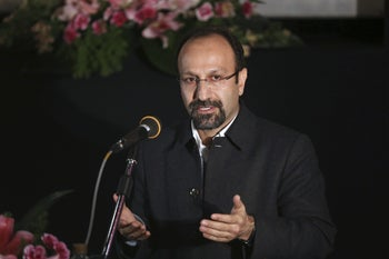 """Iranian director Asghar Farhadi, the winner of best foreign language film at 89th Academy Awards, speaks in a celebration for him, at Iran's cinema museum in Tehran, Iran, Friday, March 3, 2017. Hundreds of Iranians gathered at Tehran Cinema Museum to celebrate Asghar Farhadi's Academy Awards win for best foreign language film. The Friday gathering congratulated Farhadi and his film crew on """"The Salesman"""" with a standing ovation."""