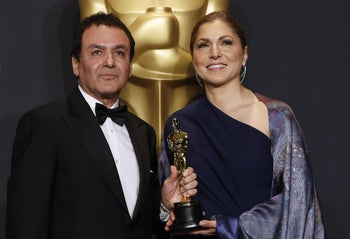 """89th Academy Awards - Oscars Backstage - Hollywood, California, U.S. - 26/02/17 - Anousheh Ansari and Firouz Naderi pose with the Oscar they accepted on behalf of Asghar Farhadi, who won the Best Foreign Language Film for """"The Salesman""""."""