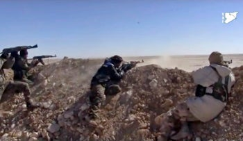 FILE PHOTO: Syria Democratic Forces (SDF) opening fire on an Islamic State group's position, in Raqqa's eastern countryside, Syria, Monday, March 6, 2017.