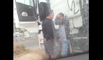 Police officer caught on video attacking Palestinian truck driver.
