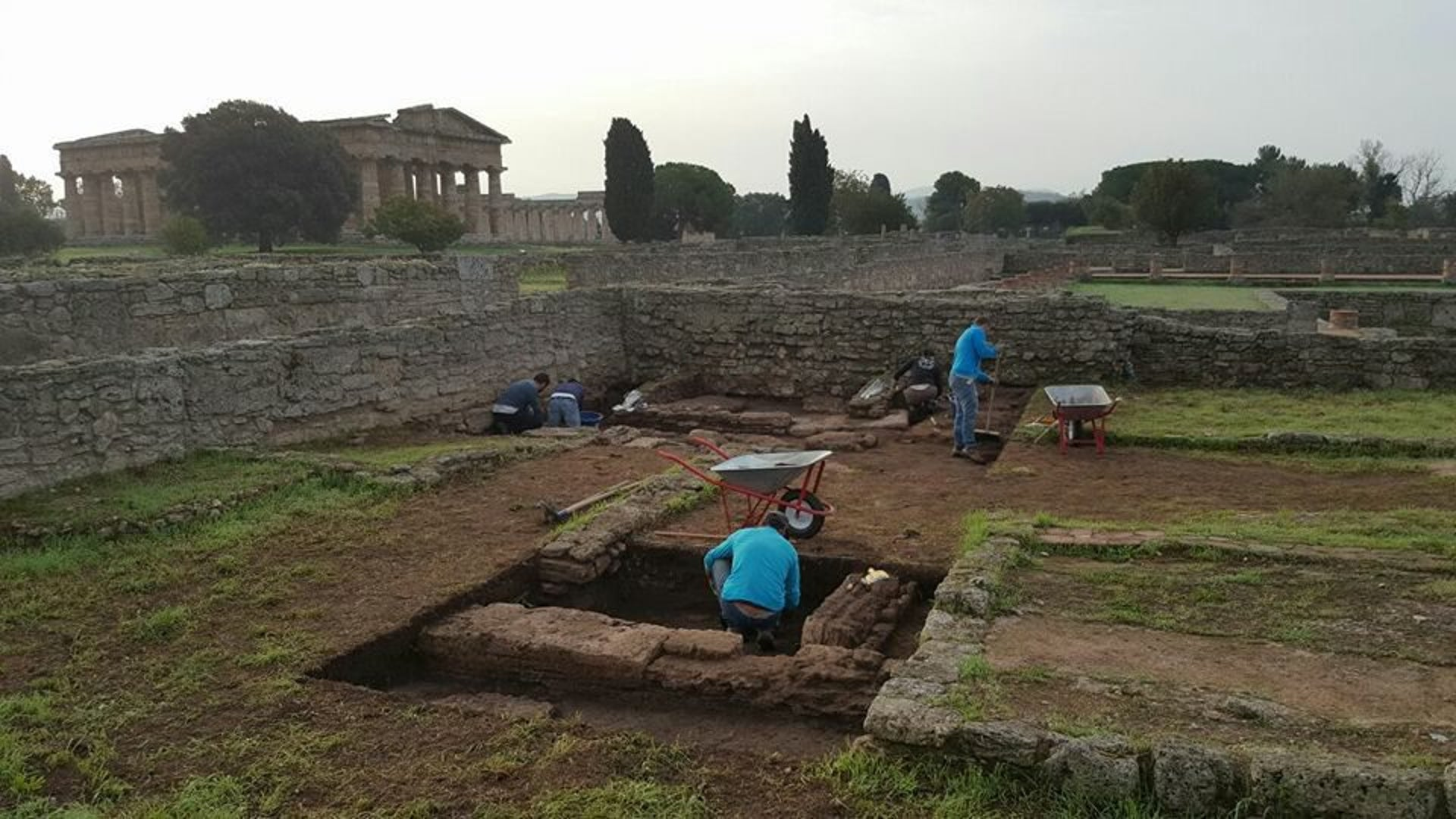 Archaeologist excavating a structure made of worked stone blocks and which is believed to date from the period when the Sybarites founded the settlement of Poseidonia in southern Italy.