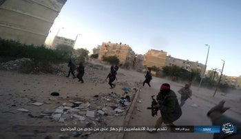Photo posted by the Islamic State Group in Sinai, a militant organization, shows a deadly attack by militants on an Egyptian police checkpoint, Monday, Jan. 9, 2017, in el-Arish, north Sinai, Egypt.