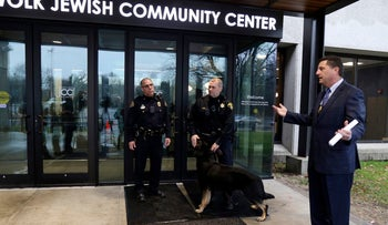 Brighton Police Chief Mark Henderson talks to reporters after a press briefing after a bomb threat was reported at the Louis S. Wolk Jewish Community Center of Greater Rochester in Brighton, N.Y on March 7, 2017