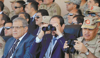 Egyptian President Abdel-Fattah al-Sissi, center, watches an Air Force exercise in 2014.