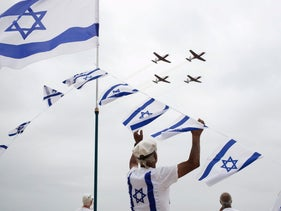 Israelis watch an air show during Independence Day in Tel Aviv, Tuesday, May 6, 2014