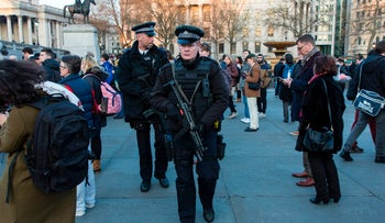 Armed police officers are seen during a vigil in Trafalgar Square in central London on March 23, 2017.