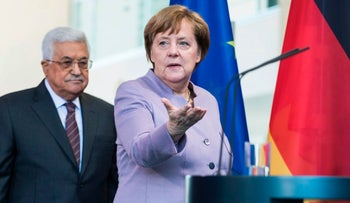 German Chancellor Angela Merkel (R) and Palestinian President Mahmoud Abbas arrive at a press conference ahead of talks on the Israeli-Palestinian conflict in Berlin, on March 24, 2017.