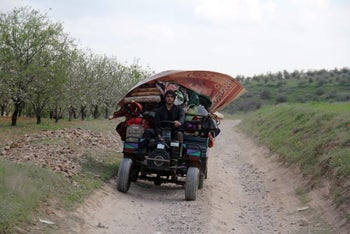 A Syrian fleeing the city of Hama, March 23, 2017.