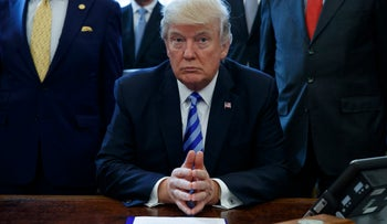 President Donald Trump pauses in the Oval Office of the White House in Washington Friday, March 24, 2017.