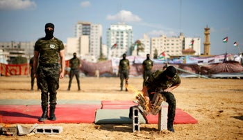 A member of Palestinian National Security Forces loyal to Hamas breaks bricks using his hand during a military graduation ceremony, in Gaza City January 22, 2017.