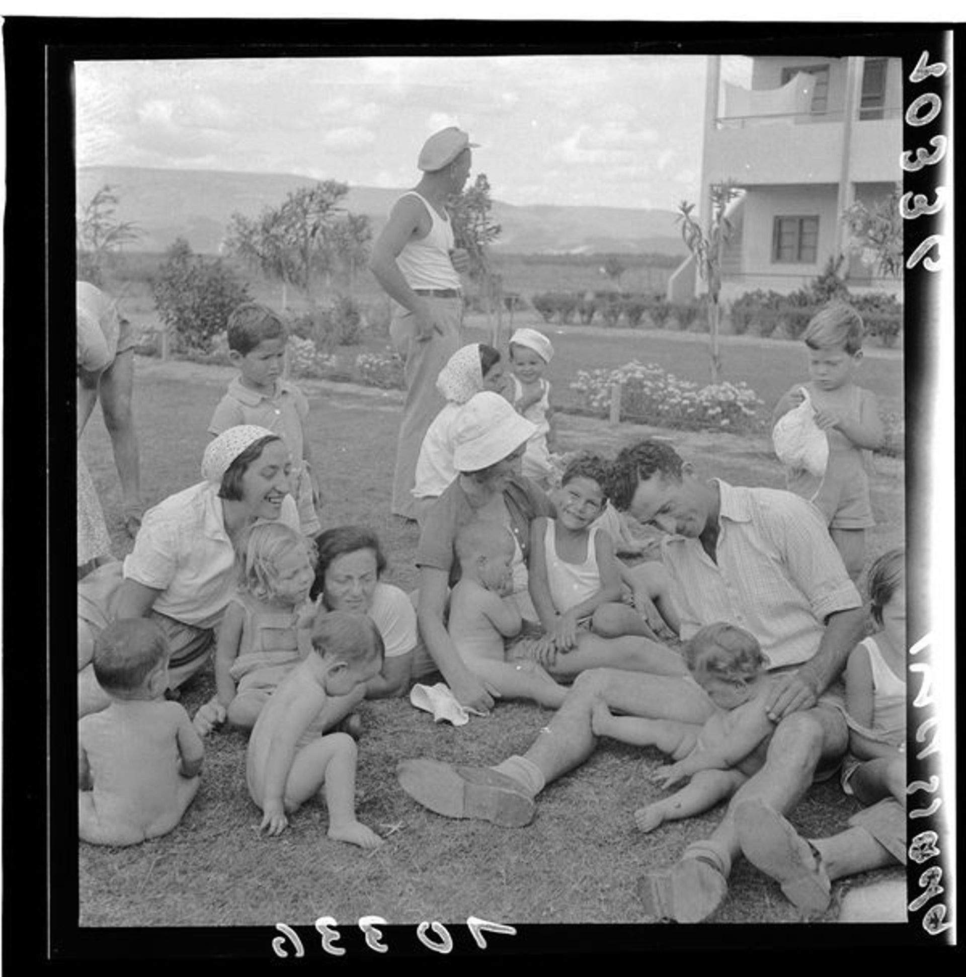Children playing with their parents at Kibbutz Masada, 1939.