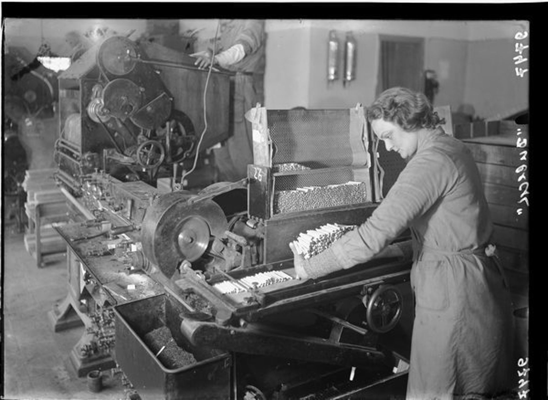 A woman working at the Dubek cigarette factory, Bnei Brak, 1939.