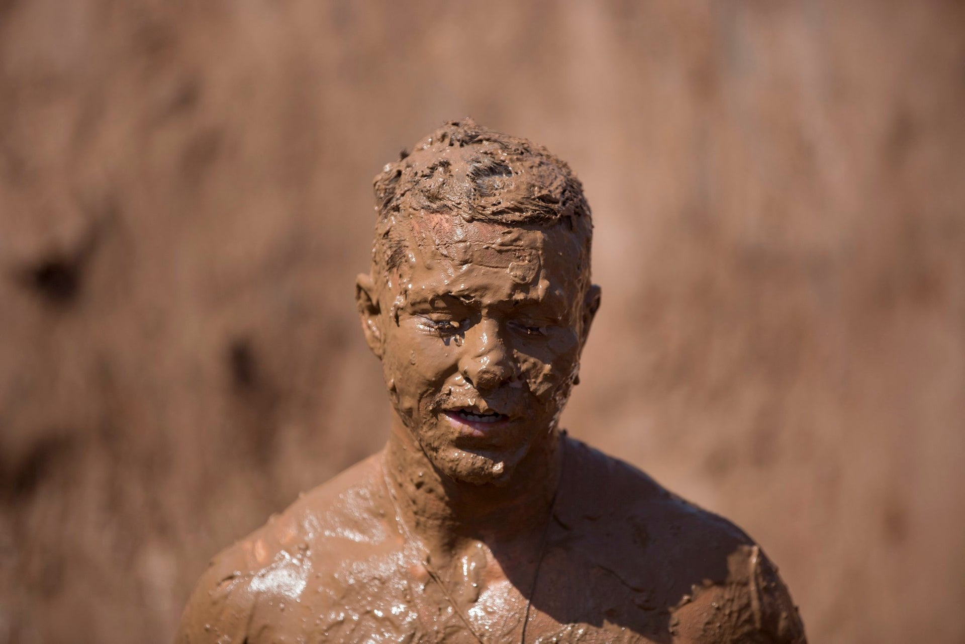 A Participant takes part in the Mud Day race, a 13km obstacle course in Tel Aviv, Israel, Friday, March 24, 2017.