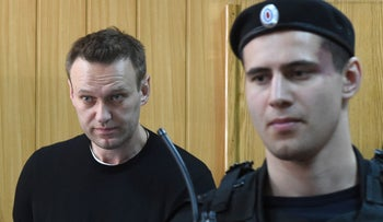 Russian opposition leader Alexei Navalny attends a hearing at a court in Moscow, March 27, 2017.
