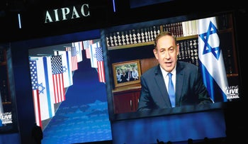 Prime Minister Benjamin Netanyahu speaks via a video link from Israel to the AIPAC policy conference in Washington, U.S., March 27, 2017.