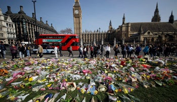 Floral tributes to the victims of the Westminster attack are placed outside the Palace of Westminster, London, March 27, 2017.