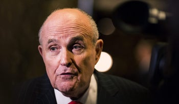 Rudolph Giuliani, former mayor of New York, speaks to members of the media in the lobby of Trump Tower in New York, U.S., on Thursday, Jan. 12, 2017.