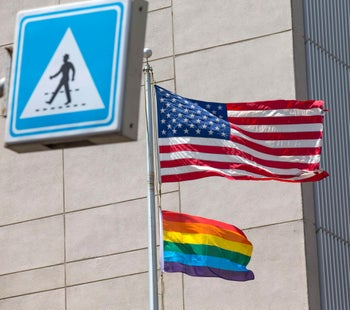 A gay pride flag is hoisted beneath a U.S. flag at the Tel Aviv embassy during a 2014 Gay Pride event.
