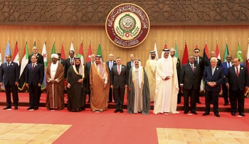 Twenty one kings, presidents and top officials from the Arab League summit pose for a group photo, at a gathering near the Dead Sea in Jordan on Wednesday, March 29, 2017.