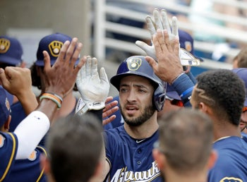 Milwaukee Brewers' Ryan Braun after scoring during a spring training baseball game against the San Francisco Giants, Wednesday, March 22, 2017.