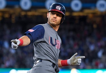 Ian Kinsler celebrates his two-run home run during the final of the World Baseball Classic, in Los Angeles, Wednesday, March 22, 2017.