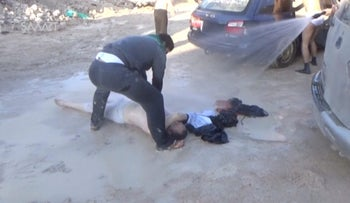 A still image taken from a video posted to a social media website on April 4, 2017, shows a man being sprayed with water, after what rescue workers described as a suspected gas attack in Idlib, Syria.