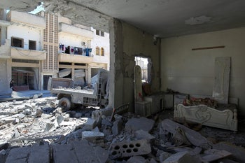 Damage at a site hit by airstrikes on Tuesday in the town of Khan Sheikhoun in rebel-held Idlib, Syria, April 5, 2017.