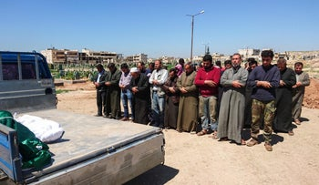 Syrians hold funeral prayers for the victims of a suspected toxic gas attack in Idlib, Syria on April 5, 2017.